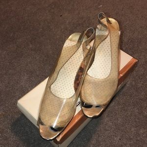 Used clear sling back heels